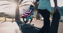 African American Skater Doing Ollie while Holding American Flag - stock footage