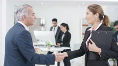 4K Smiling Western & Arab business people meeting & shaking hands in office - stock footage