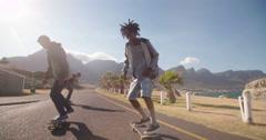 Multi-Ethnic Group of Skaters Skateboarding Down Street at Seasi Stock Footage