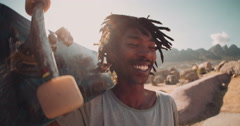 African American Skater Stands, Smiles and holding Skateboard Stock Footage