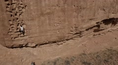Two Rock Climbers near Moab, Utah, Panning Aerial Footage - stock footage