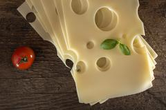 Slices of Emmental cheese Stock Photos
