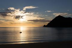 Kayaking at sunrise in Abel Tasman National Park - stock photo