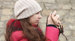Girl photographs on a film camera, side view Stock Footage