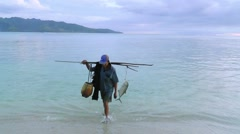 Fisherman is returning with their catch Stock Footage
