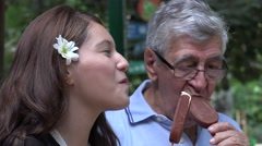 Teen Girl And Grandfather Eating Popsicles Stock Footage