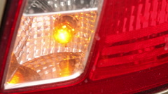 Light indicator blinks at the back of the vehicle headlight Stock Footage