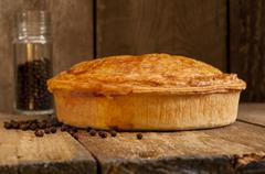 Whole Meat Pie with Spice Jar Stock Photos