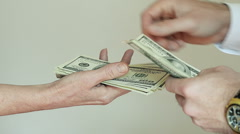 Paying Cash from Man Hands Counting out 100 Dollar Bills into a Woman Hand Stock Footage