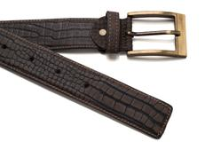 Tip and Buckle of Faux Crocodile Leather Belt - stock photo