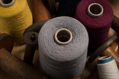 Spools of Color Thread with Empty Wooden Spools Stock Photos