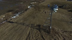 4k aerial windmill starts to spin in wind - stock footage