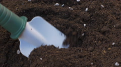Mixing dirt with fertilizer with hand shovel Stock Footage