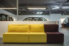 Multi-colored sofa in moder interior - stock photo