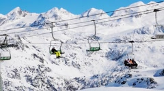 Stock Video Footage of Skier with chairlift with snow-covered montains