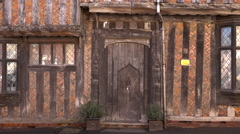 Stock Video Footage of Lavenham England medieval crooked cottage front door 4K