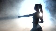 Karate girl. Black. Silhouette. Backlight Stock Footage