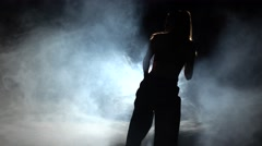 Girl shows karate techniques. Black. Silhouette. Backlight Stock Footage