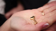Woman hand with a wedding ring holding a key Stock Footage