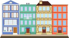 Four colored houses on the old street Stock Illustration
