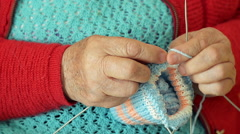 Close-up of a Grandmother Knitting Wool Socks Stock Footage