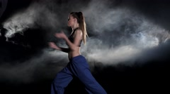 Girl is engaged in martial arts. Black Stock Footage