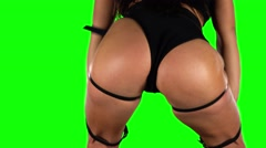 Girl in black shorts and top sexy booty dancing. Green,. Closeup - stock footage