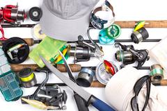 fishing tackles, equipment and caps - stock photo