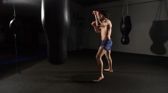 muscular handsome fighter giving a forceful forward kick during a practise round - stock footage