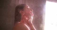 Happy beauty woman skin care in shower - stock footage