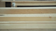 The manufacture of building materials from wood using the circular saw - stock footage