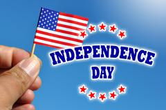 Independence Day usa banner with american flag in blue sky background - stock photo