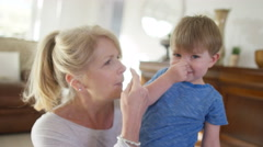 4K Portrait of happy attractive mature woman playing with cute grandson - stock footage