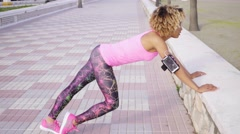Supple athletic woman doing stretching exercises Stock Footage