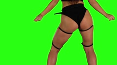 Girl in black shorts and top sexy booty dancing. Green. Closeup - stock footage