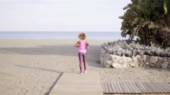 Single woman stretching arms outward at beach Stock Footage