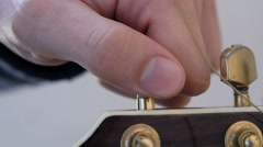 Fine tuning guitar E string Stock Footage