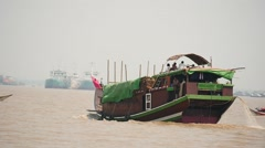 Traditional Myanmar boat view  from other vessel slow motion , Yangon port Stock Footage