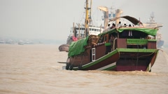 traditional old looking ship in Yangon port slow motion around, Myanmar - stock footage