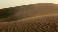 Camel and camel rider walk through the Thar desert ,Jaisalmer,rajasthan Stock Footage
