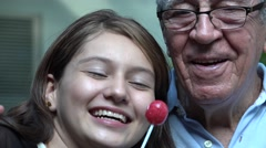 Grandfather And Teen Girl With Lollipops Stock Footage