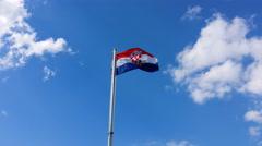 4K, Croatian flag fluttering on a pole over beautiful sky Stock Footage