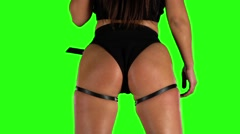 Girl in black shorts and top sexy booty dancing. Green. Slow motion - stock footage