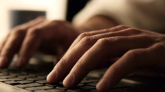 Close up footage of male hands typing on laptop keybord Stock Footage