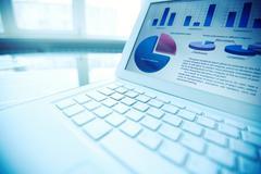 Financial data in laptop Stock Photos