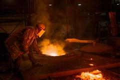 Hard work in a Foundry, Melting Iron - stock photo