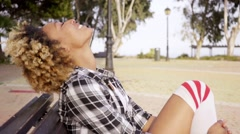 Stock Video Footage of Contented woman with eyes closed at park