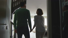16 70 14 Happy Couple Walking into New home and Looking Around - stock footage