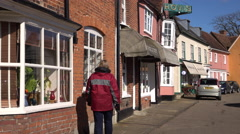 Lavenham England woman shopping village center 4K Stock Footage