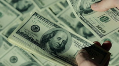Close-up Man is Counting His Money.100$ Banknotes. Stock Footage